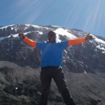 Profile image of tour guide Dennis Shayo